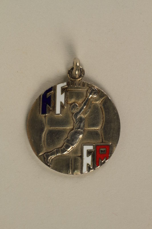 2005.602.5.2 front French Deaf-Mute National Cup basketball medal awarded to a German Jewish athlete