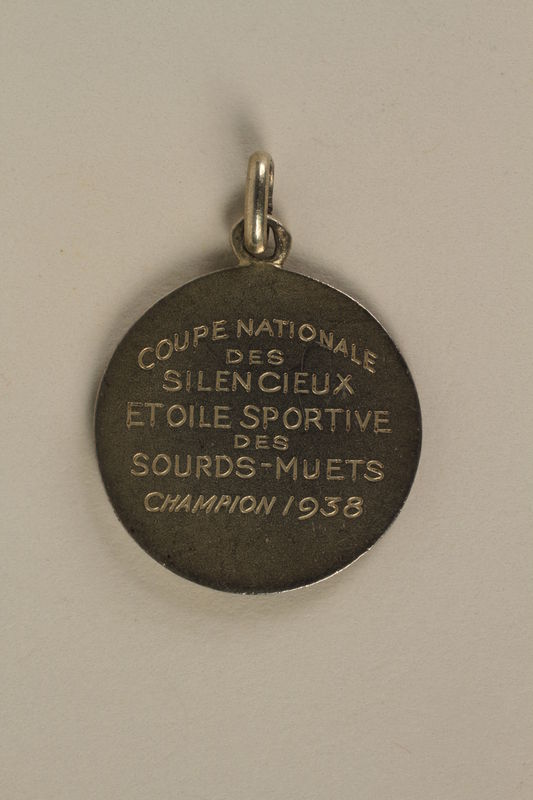 2005.602.5.2 back French Deaf-Mute National Cup basketball medal awarded to a German Jewish athlete