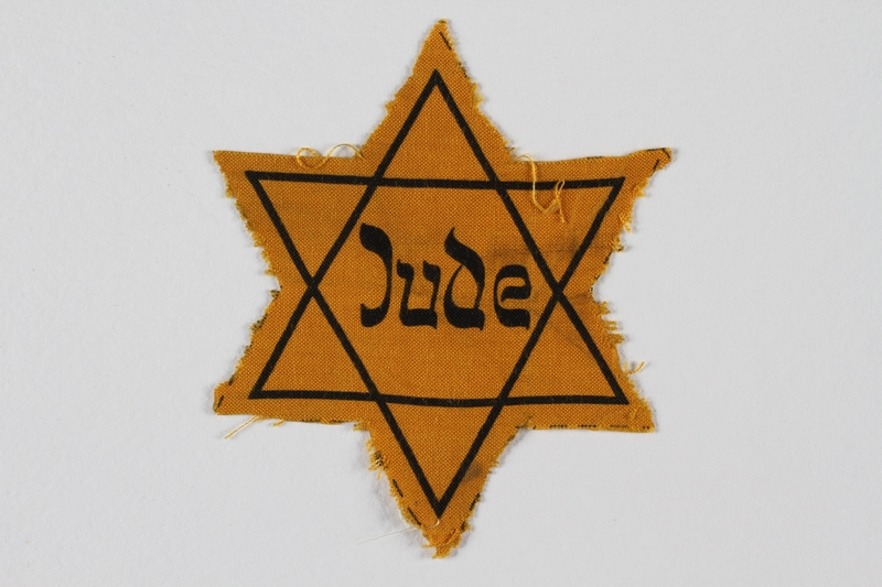 1991.141.4 front Unused Star of David badge with Jude issued to a German Jewish youth