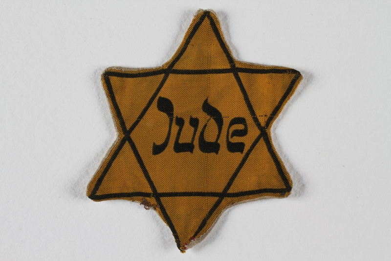 1991.141.5 front Star of David badge with Jude worn by a German Jewish youth