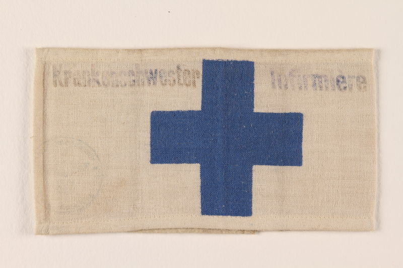 2007.212.2 front Blue cross armband worn by a Jewish Russian nurse caring for refugee children