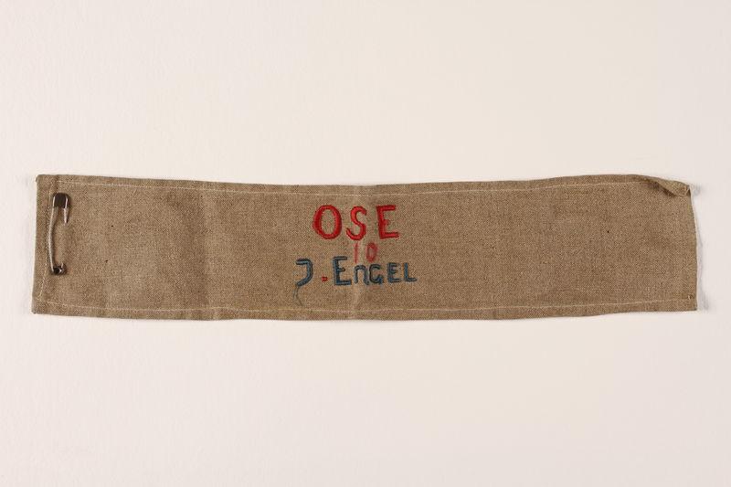 1991.145.1 front OSE (Ouevre de Secours aux Enfants) armband
