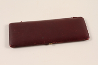 2011.433.1 closed Red leather photograph case carried by a Jewish Austrian refugee  Click to enlarge