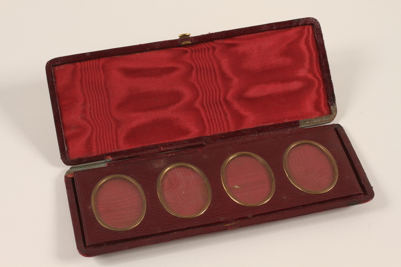 2011.433.1 open Red leather photograph case carried by a Jewish Austrian refugee