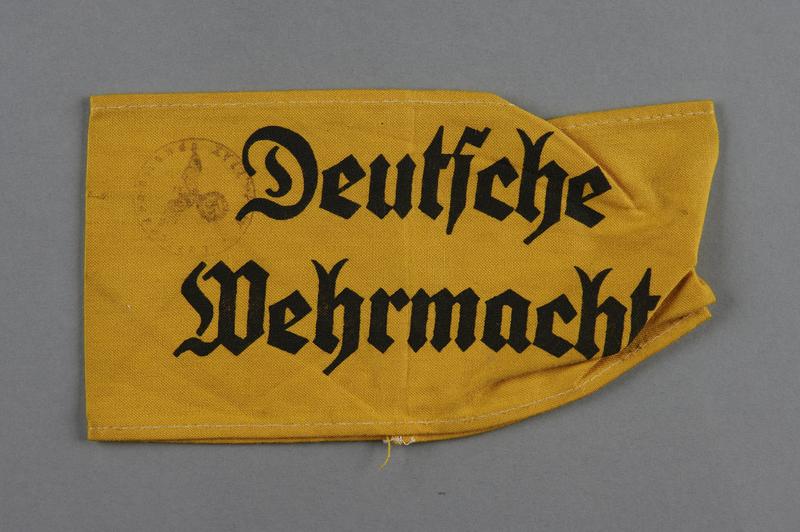 2002.327.2 front Yellow cloth armband printed Deutsche Wehrmacht