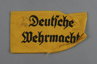 2002.327.2 front Yellow cloth armband printed Deutsche Wehrmacht  Click to enlarge