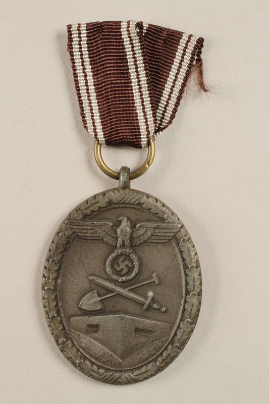 2002.327.14 front Westwall Defense medal