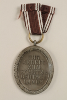 2002.327.14 front Westwall Defense medal  Click to enlarge