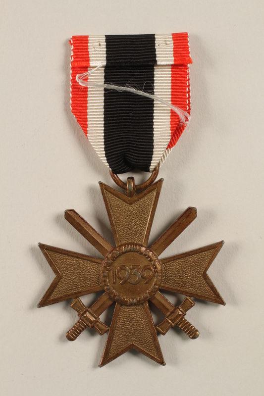 2002.327.18 back War Service Cross Medal