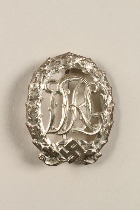 2011.259.5 front DRL Sport Badge, silver grade with swastika, owned by German Jewish refugee