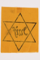 2010.502.2 back Unused Star of David badge with Juif owned by a German Jewish refugee  Click to enlarge