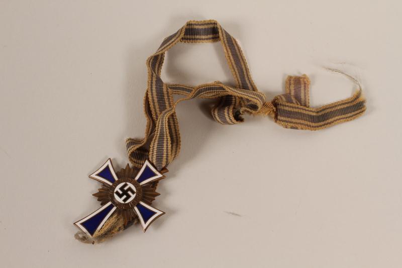 2012.248.1 front Cross of Honor of the German Mother [Ehrenkreuz der deutschen Mutter] medal, 3rd Class Order, Bronze Cross