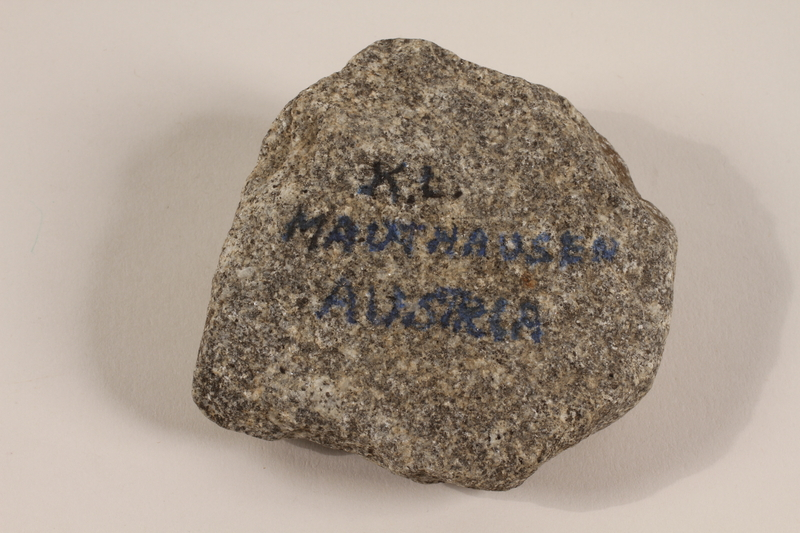 1991.160.2 front Building stone from a concentration camp owned by a former Polish Catholic inmate