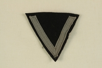 2003.112.2 front Unused Waffen SS sleeve chevron acquired postwar by a US soldier  Click to enlarge