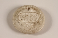 2003.112.18 front Crematorium tag, number 5896, acquired at Dachau postwar by a US soldier  Click to enlarge