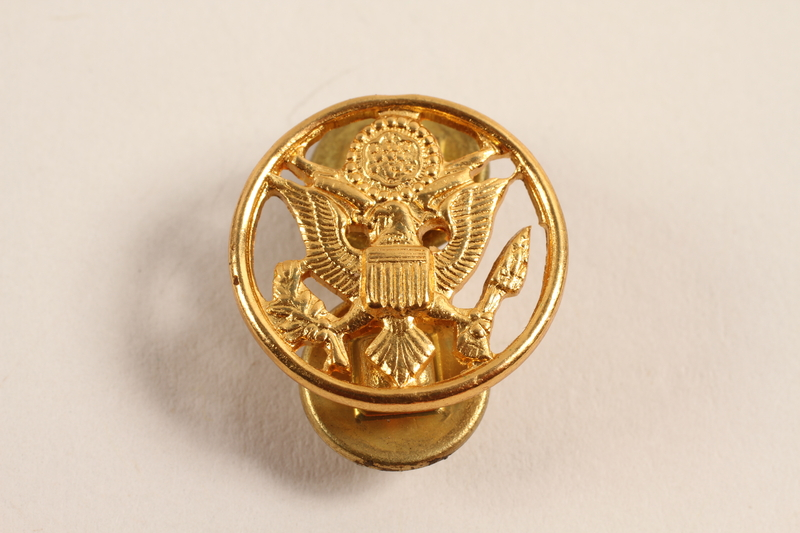 2003.149.10 front Great Seal of US lapel pin worn by a Jewish German US soldier