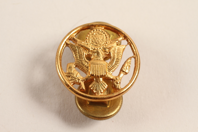 2003.149.11 front Great Seal of US lapel pin worn by a Jewish German US soldier