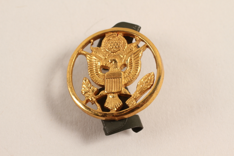 2003.149.12 front Great Seal of US lapel pin worn by a Jewish German US soldier