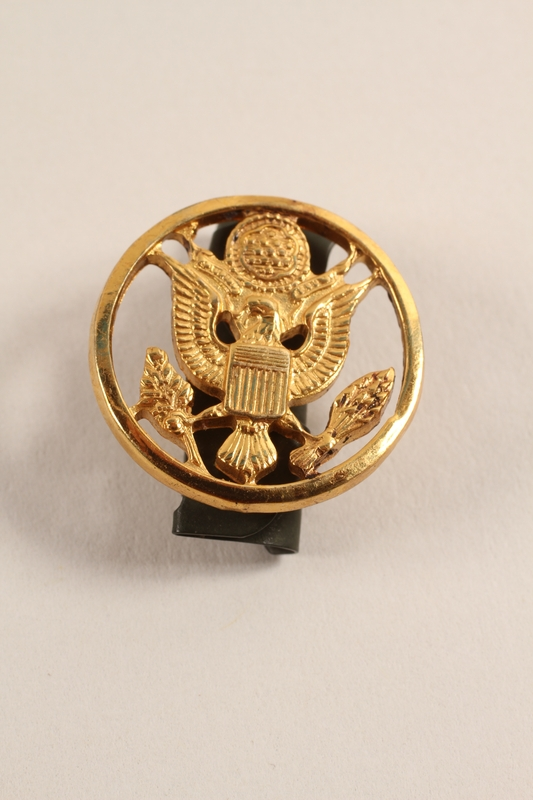 2003.149.13 front Great Seal of US lapel pin worn by a Jewish German US soldier