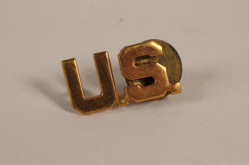 2003.149.27 front U.S. lapel pin worn by a German Jewish US soldier