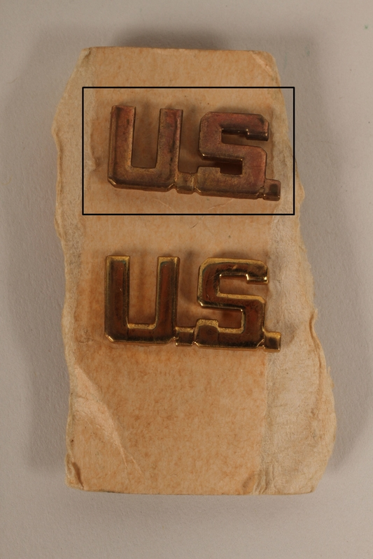 2003.149.29.1 front Copper colored U.S. lapel pin received by a German Jewish US soldier