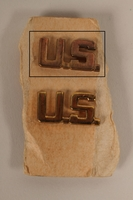 2003.149.29.1 front Copper colored U.S. lapel pin received by a German Jewish US soldier  Click to enlarge
