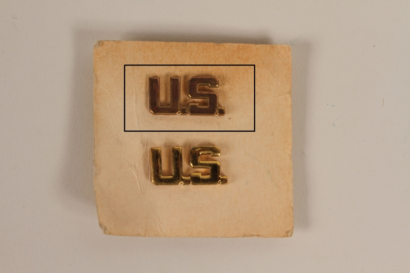 2003.149.30.1 front Copper colored U.S. lapel pin owned by a German Jewish US soldier