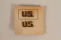 2003.149.30.1 front Copper colored U.S. lapel pin owned by a German Jewish US soldier  Click to enlarge