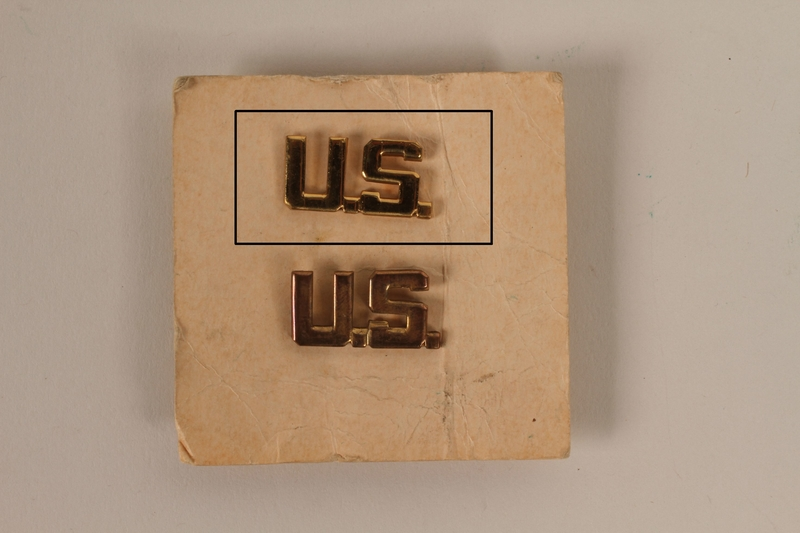 2003.149.31.1 front U.S. lapel pin received by a German Jewish US soldier