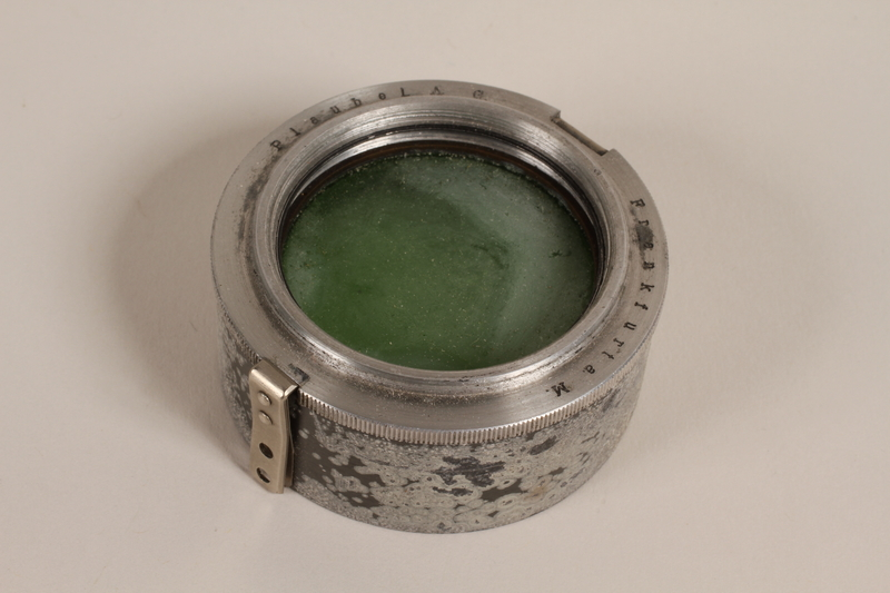 2003.149.38_b front Plaubel camera lens hood with green filter and case used by German Jewish US soldier
