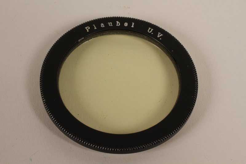 2003.149.42_c front Four Plaubel color camera filters, lens, and case used by German Jewish US soldier