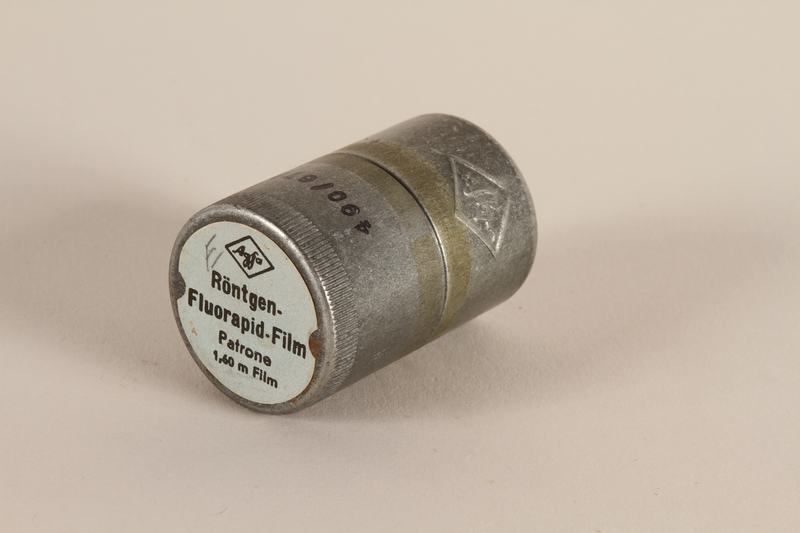 2003.149.47_a-b closed Agfa metal film canister used by a German Jewish US soldier