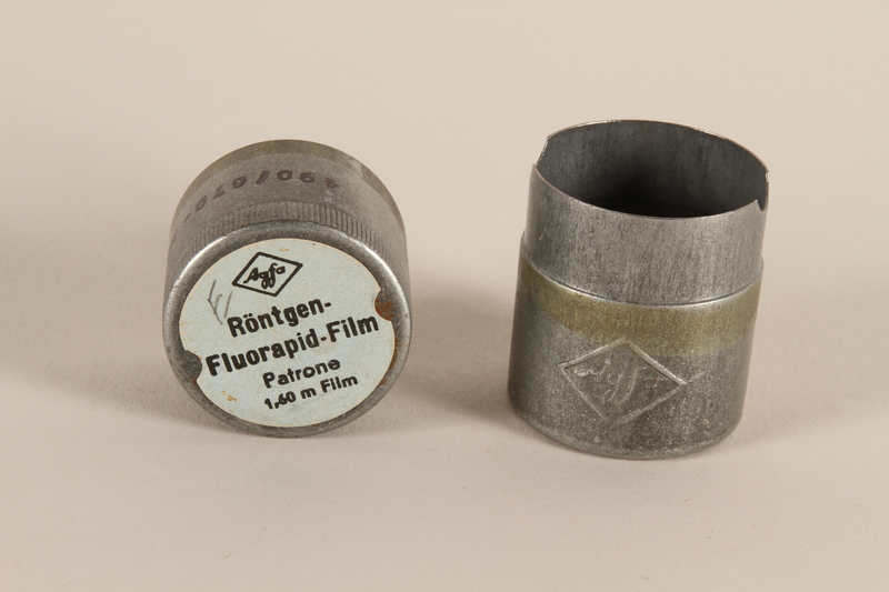 2003.149.47_a-b open Agfa metal film canister used by a German Jewish US soldier