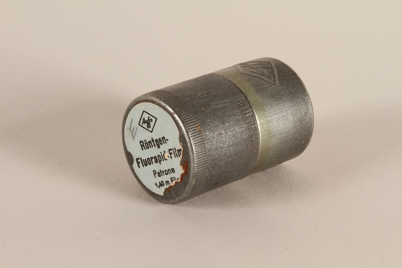 2003.149.48_a-b closed Agfa metal film canister used by German Jewish US soldier