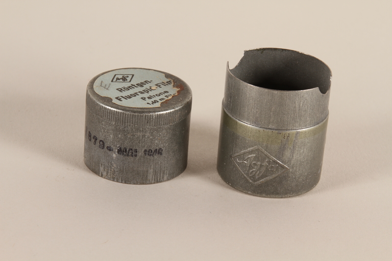 2003.149.48_a-b open Agfa metal film canister used by German Jewish US soldier