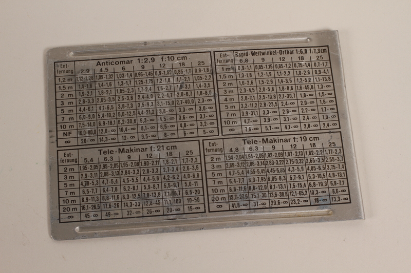 2003.149.56 front Depth of field scale plate for Plaubel camera used by German Jewish US soldier
