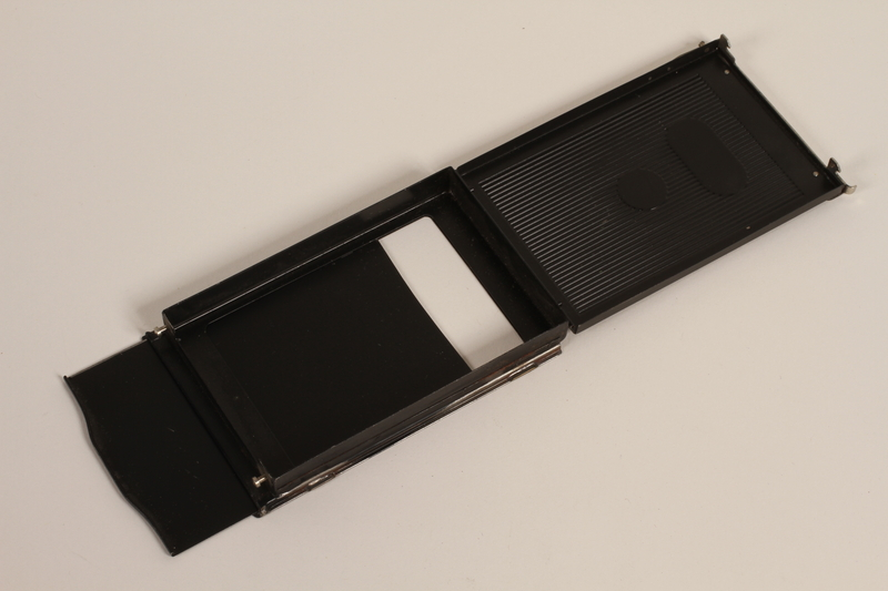 2003.149.59 open Hinged pack film holder used by German Jewish US soldier