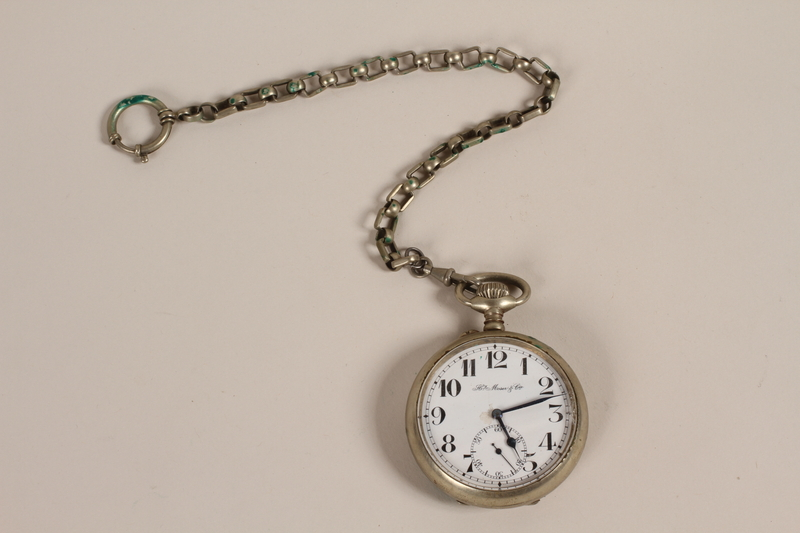 2003.149.60_a-b front H. Moser & Cie silver pocket watch with chain owned by German Jewish US soldier