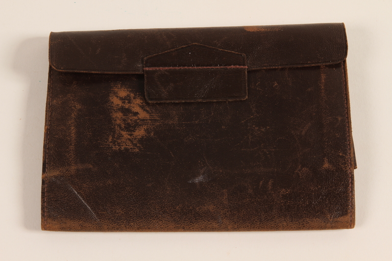 2003.149.63 front Dark brown leather document wallet used by German Jewish US soldier