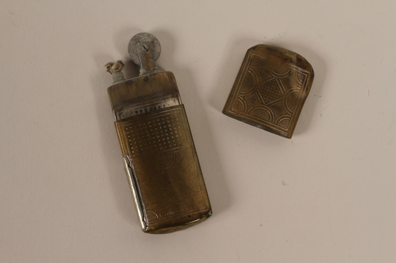 2003.149.69 open Reusable embossed cigarette lighter used by German Jewish German US soldier