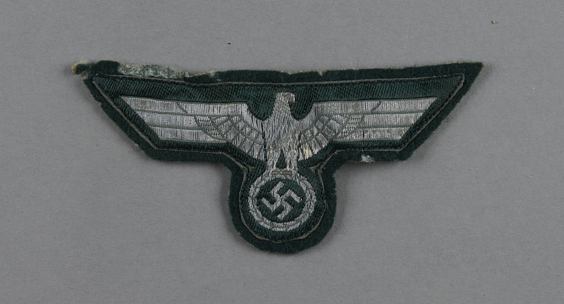 2003.149.73 front Wehrmacht silver bullion eagle insignia patch acquired by German Jewish US soldier