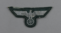 2003.149.73 front Wehrmacht silver bullion eagle insignia patch acquired by German Jewish US soldier  Click to enlarge