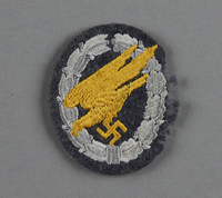 2003.149.74 front Luftwaffe paratrooper badge with gold diving eagle acquired by German Jewish US soldier  Click to enlarge