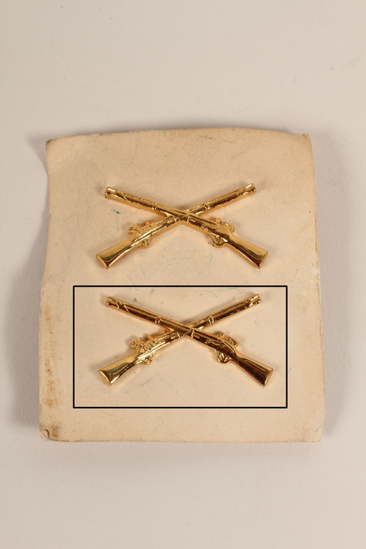 2003.149.26.2 front Infantry service lapel pin from a pair received by German Jewish US soldier