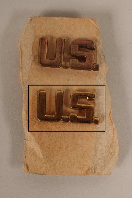 2003.149.29.2 front U.S. lapel pin from a pair owned by a German Jewish US soldier