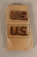 2003.149.29.2 front U.S. lapel pin from a pair owned by a German Jewish US soldier  Click to enlarge