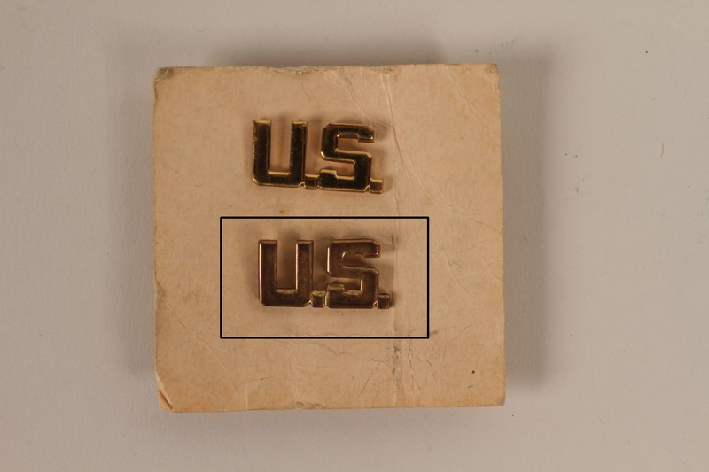 2003.149.31.2 front Copper colored U.S. lapel pin received by a German Jewish US soldier