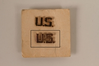 2003.149.31.2 front Copper colored U.S. lapel pin received by a German Jewish US soldier  Click to enlarge