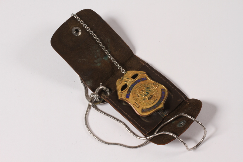2011.395.3 open US Army Military Intelligence ID badge in case used by a Jewish American soldier