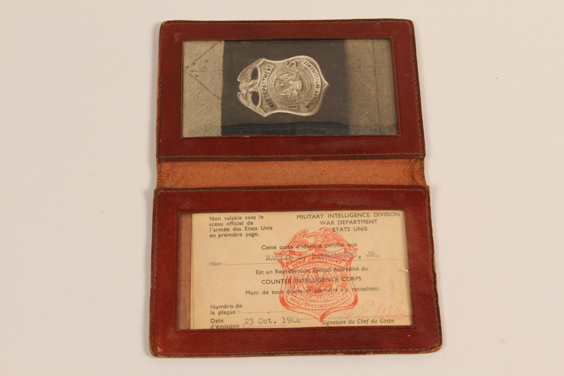 2011.395.4 open Leather document holder with CIC credentials used by a Jewish American soldier